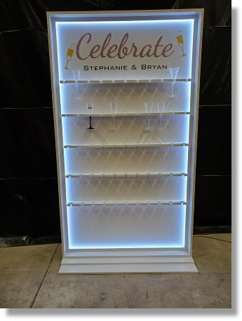 Uniquely DC - DC Scenic fabrication and rental of champagne toast walls, champagne flute walls